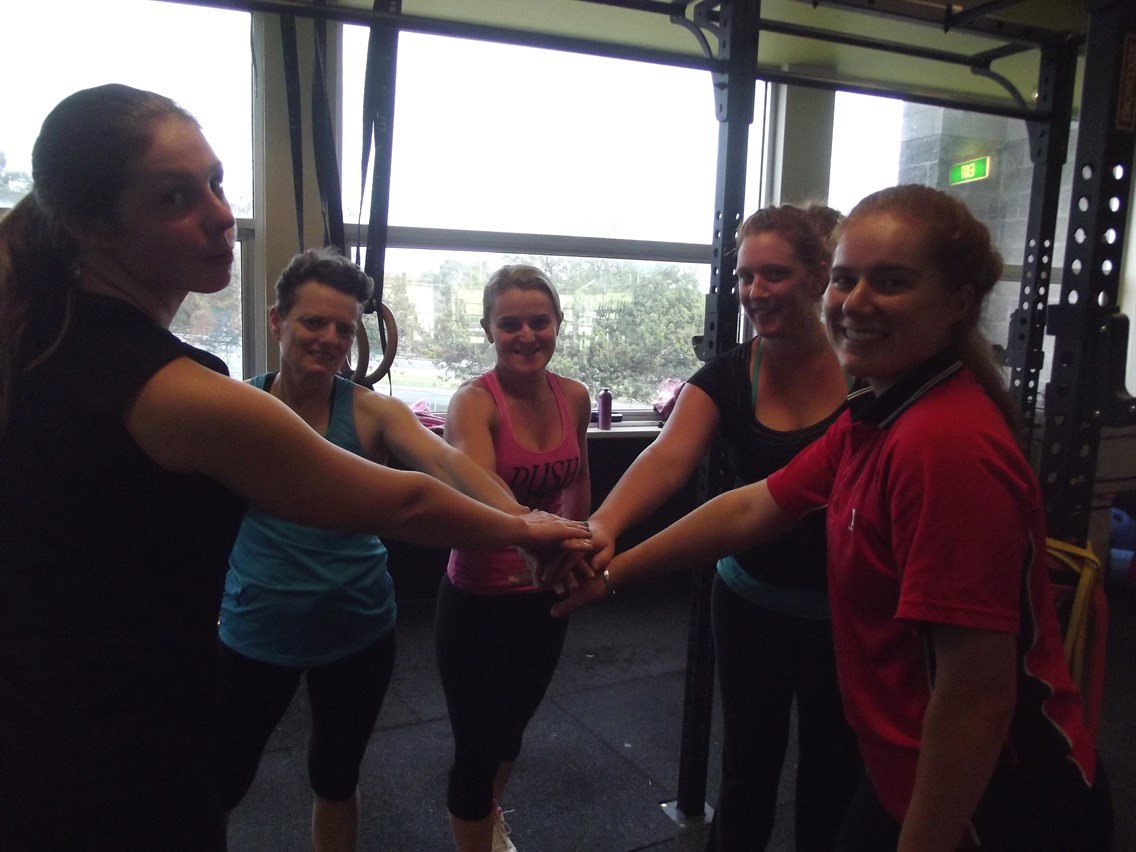 Group of girls putting hands in