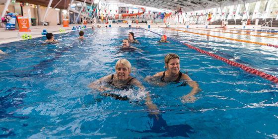 Women swimming in 50 metre pool