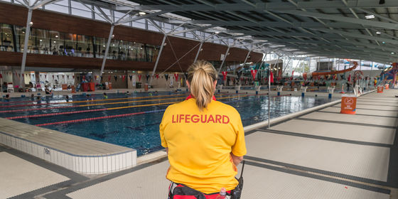 Lifeguard watching over 50 metre pool