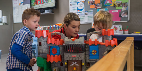 Children playing with toy castle.