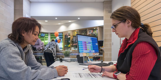 Two women at information desk