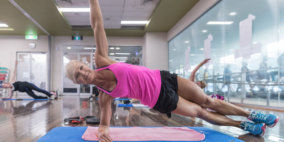 Woman doing Yoga in Group Fitness class